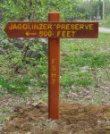 Sign marking start of preserve 250 feet from the road.